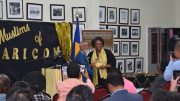 PM Mia Amor Mottley receiving a copy of Muslims of CARICOM from author Sabir Nakhuda